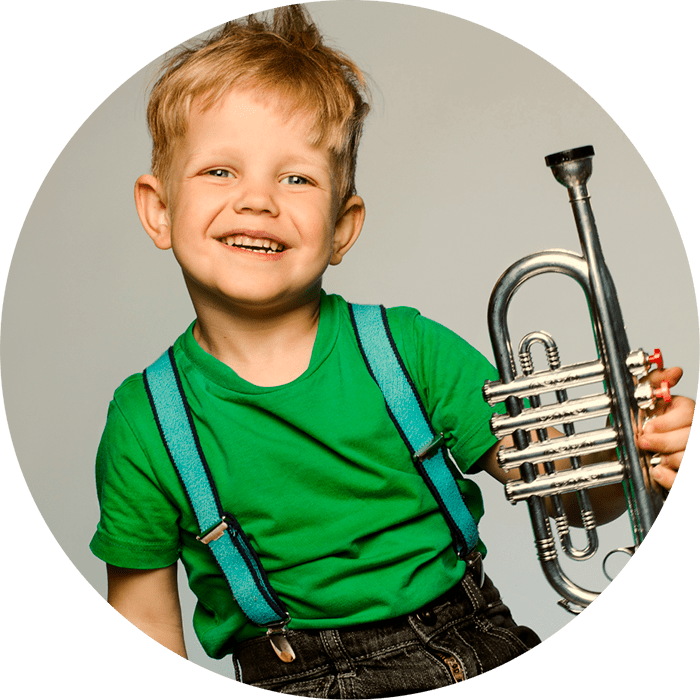 Photo of boy with trumpet, background: gray color